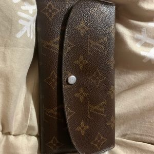 Authentic Louis Vuitton wallet. Holds 8 cards.